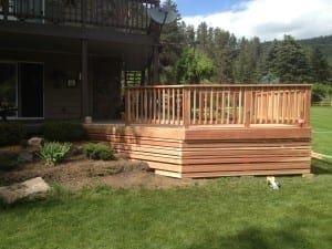 redwood deck with basic railing